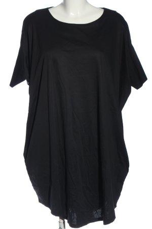 COS Camisa holgada negro look casual