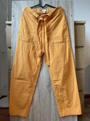 COS Spodnie z zakładkami jasny pomarańczowy