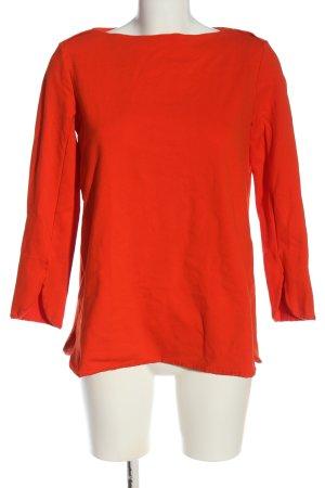 COS Suéter rojo look casual