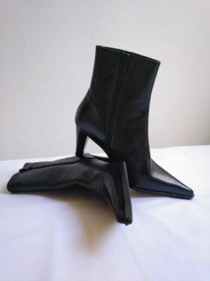Botines estilo vaquero negro Cuero