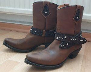 Botines estilo vaquero marrón