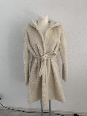 Manteau en fausse fourrure crème-blanc cassé