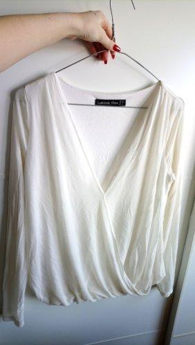 cremefarbene Bluse mit V Ausschnitt