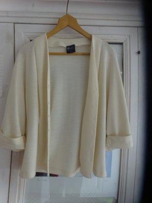 Wełniany sweter w kolorze białej wełny