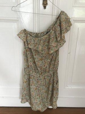 Cremefarbener Jumpsuit mit floralem Muster von Zara