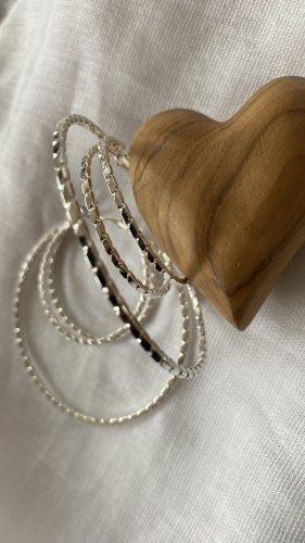 Six Pendientes tipo aro color plata