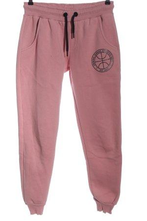 Criminal Damage Pantalón deportivo rosa-negro estampado temático look casual