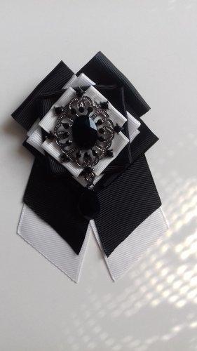 Broche blanco-negro tejido mezclado