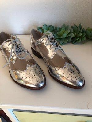 Aldo Zapatos brogue color plata