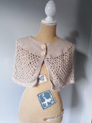 Poncho en tricot beige