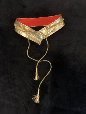 Gold house Cinturón pélvico color oro-rojo