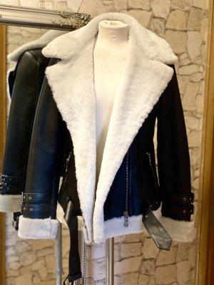 Giacca in pelliccia nero-bianco