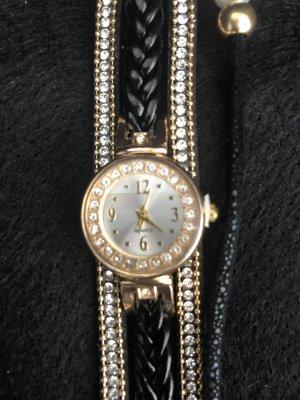Reloj analógico negro-color oro