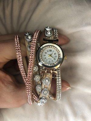 Reloj analógico beige-color rosa dorado