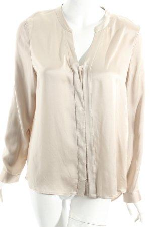 Blusa brillante beige elegante