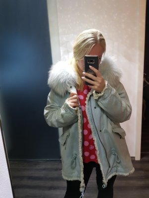 Manteau en duvet bleu pâle