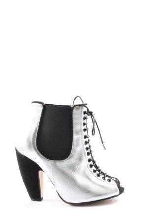 Deena & Ozzy Peeptoe Pumps silberfarben-schwarz extravaganter Stil