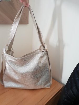 Designer Lederbeutel als Tasche / Rucksack  gold