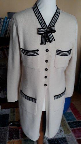 la Passion de Maggy Manteau en tricot noir-blanc cassé