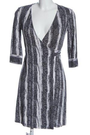 Diane von Furstenberg Vestido cruzado negro-blanco look casual
