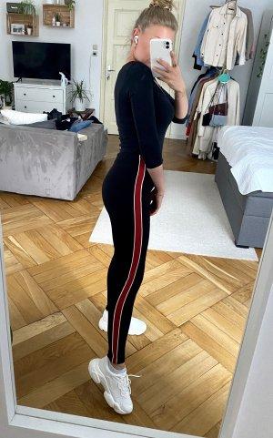 Dicke schwarze Leggins mit roten steifen Zara XS