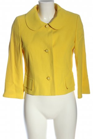Dolce & Gabbana Blazer corto amarillo pálido look casual