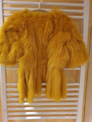 Dolce & Gabbana Veste de fourrure orange doré