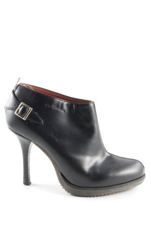 Dr. Martens Pumps met hoge zool zwart extravagante stijl