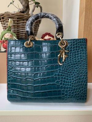 Drei färbige Handtasche