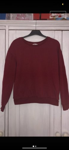 Dunkel roter Pullover