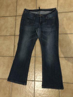 dunkelblaue / blaue Stretchjeans / Jeans / Schlaghose / Schlagjeans mit Cuttings und Waschung von Rainbow / Bonprix - Gr. 46