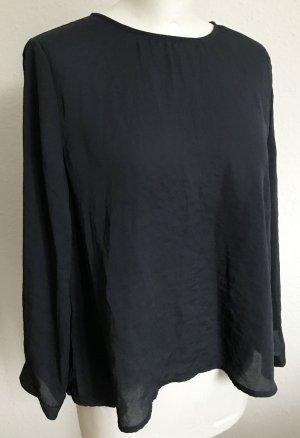 Dunkelblaue Bluse mit Knopfleiste im Rücken
