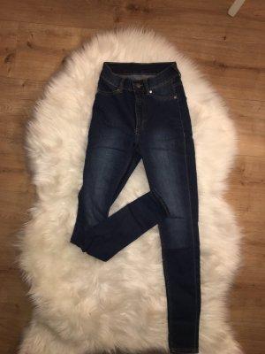 Dunkelblaue skinny Jeans
