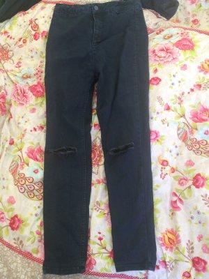 Dunkelblaue Stretch Jeans mit Löchern