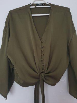 dunkelgrüne Bluse zum Binden