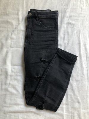 dunkle High-Waist Jeans mit Löchern
