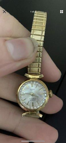 Analoog horloge goud