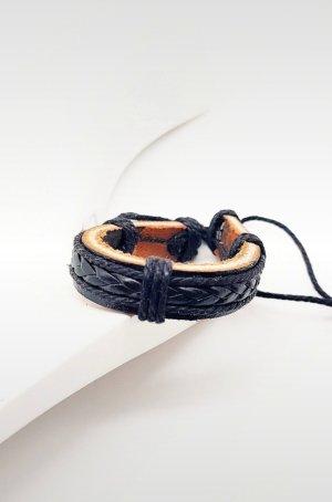 Skórzane ozdoby na ręce  czarny