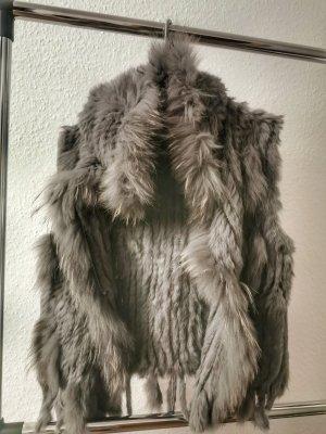 Smanicato di pelliccia grigio