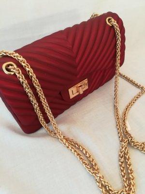 edle Handtasche mit goldenen Trägern und Verschluß