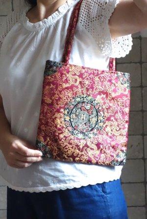Edles kleines Täschchen, Stofftasche aus Seidentaft (Viskose/Seide) mit chinesischen Motiven, pink gold gemustert, gefüttert mit Innentasche, mit Zipp zu schließen, gepolsterten Henkel, kleines, feines Täschchen, neuwertig
