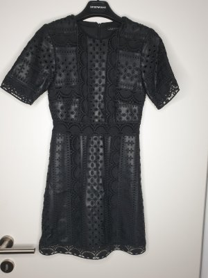 Edles mini Kleid aus Fabric und Leder.