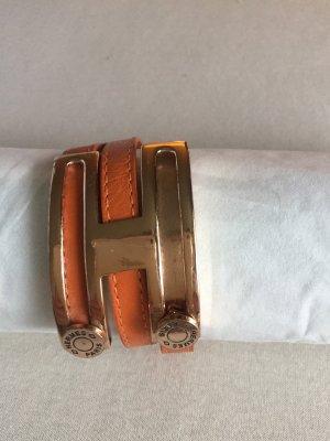 Bracelet en cuir orange foncé
