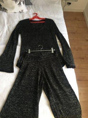Ein Satz schwarzer und silberner Pullover und Hosen