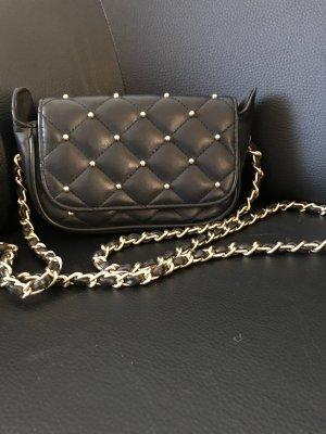Clutch black-gold-colored