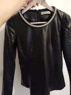 Blusa de cuero negro-color plata
