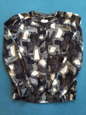 Elegante Bluse in schwarz weißem abstrakten Muster von Nümph