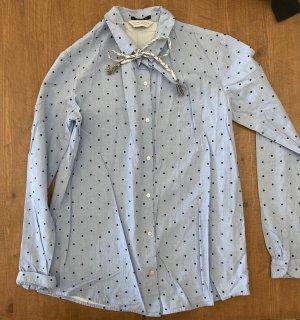 elegante Bluse mit Samtpunkten und Kordel am Kragen