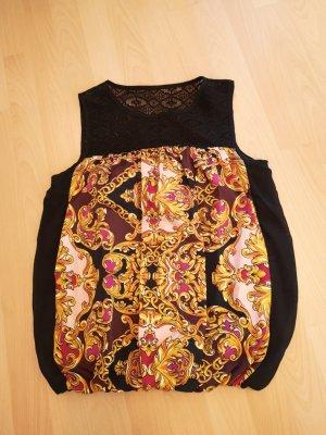 Elegante Bluse mit Spitze. Farben schwarz, Gold und rosa