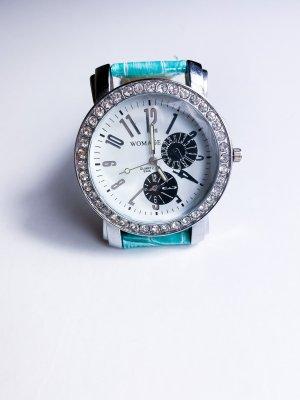 Orologio analogico turchese-argento